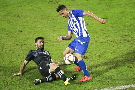 alexandros: Thessaloniki, Greece, Oktober18 2015: Alexandros Tziolis (L) of Paok and Jonh Pasas of Hercules (Iraklis) (R) in action during the Greek Superleague match PAOK vs Hercules (Iraklis) Editorial