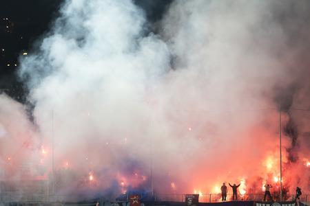 fanatics: Thessaloniki, Greece, Oktober18 2015: Fans and supporters of Hercules (Iraklis) team light flares  during the Greek Superleague match PAOK vs Hercules (Iraklis) Editorial
