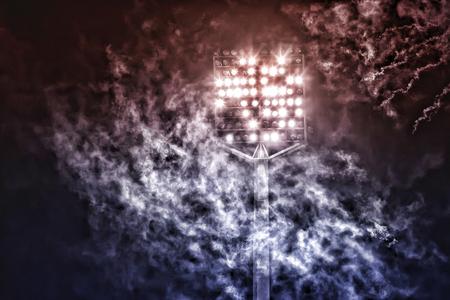 floodlit: stadium lights and smoke