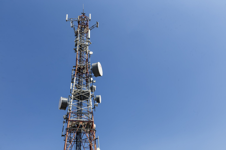 telco: communications tower with antennas against blue sky Stock Photo