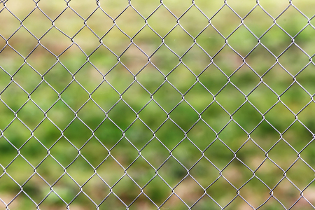 kratka: Rusty metal grille fence macro and nature background