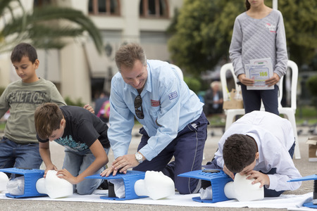 Thessaloniki, Greece, Oktober16 2015: The instructor showing CPR on training doll. Free First Aid, CPR lessons given in the center of Thessaloniki, Greece. Editorial