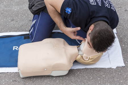 chest compression: Thessaloniki, Greece, Oktober16 2015: The instructor showing CPR on training doll. Free First Aid, CPR lessons given in the center of Thessaloniki, Greece. Editorial