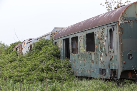 caboose: Old and abandoned passenger train wagons in nature Stock Photo