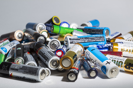 recycling center: Thessaloniki, Greece- March 26, 2015: Different types of used batteries ready for recycling lying in a heap at a recycling center in Thessaloniki, Greece.