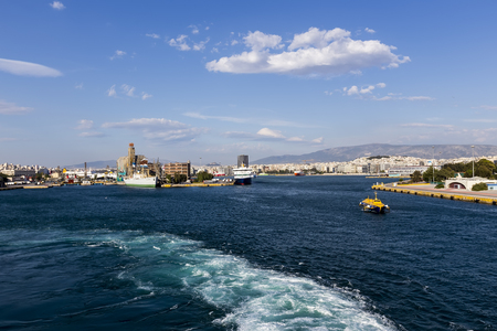docking: Pireas, Greece- May 12, 2015: Ferry boats, cruise ships docking at the port of Piraeus, Greece. The port of Piraeus is the largest passenger port in Europe and the third largest in the world.