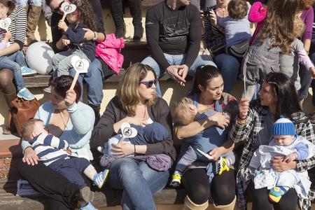breastfeeding nude: Thessaloniki, Greece, November 1 2015: Mother breastfeeding her baby on the 6th Nationwide public breastfeeding in celebration of World Breastfeeding Week Editorial