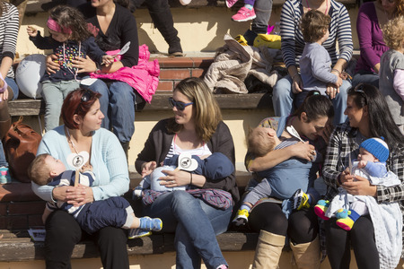 breastfeeding: Thessaloniki, Greece, November 1 2015: Mother breastfeeding her baby on the 6th Nationwide public breastfeeding in celebration of World Breastfeeding Week Editorial