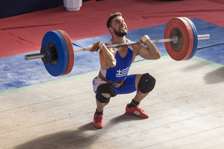 weight room: Thessaloniki, Greece, Oct 2 2015: Unknown athlete in his attempt to lift the weights during the course of the Greek Weightlifting Championship Editorial