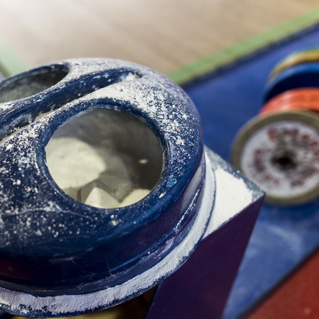 receptacle: Thessaloniki, Greece, Oct 3 2015: Closeup receptacle with talcum powder during the course of the Greek Weightlifting Championship