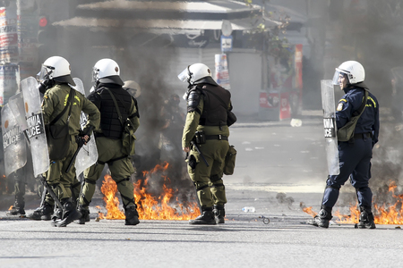 violent: Athens, Greece, November, 12 2015: Clashes have broken out between riot police and youths at a demonstration in central Athens during the general strike. Editorial