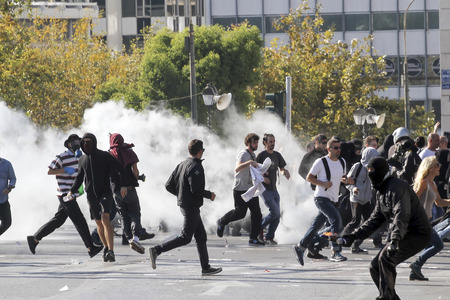 Athens, Greece, November, 12 2015: Clashes have broken out between riot police and youths at a demonstration in central Athens during the general strike. 報道画像