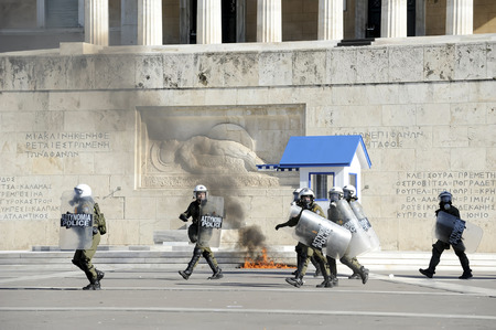 clashes: Athens, Greece, November, 12 2015: Clashes have broken out between riot police and youths at a demonstration in central Athens during the general strike. Editorial