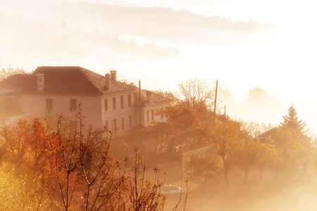 lonley: autumn scenery up early with fog in Zagorochoria, Epirus Greece (soft focus). Cross processed image for vintage look Stock Photo