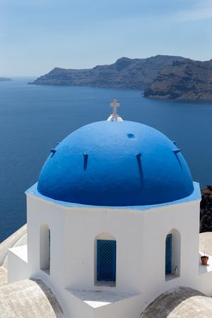 greek islands: Blue domed churches on the Caldera at Oia on the Greek Island of Santorini.