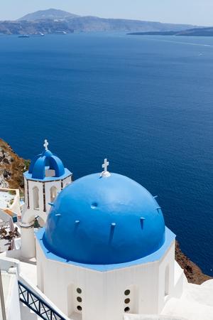 caldera: Blue domed churches on the Caldera at Oia on the Greek Island of Santorini.