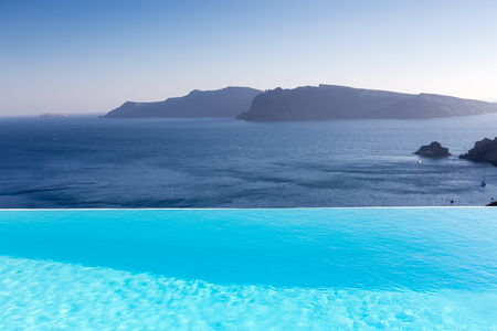 Infinity pool on the rooftop with the ocean in Santorini Island, Greece