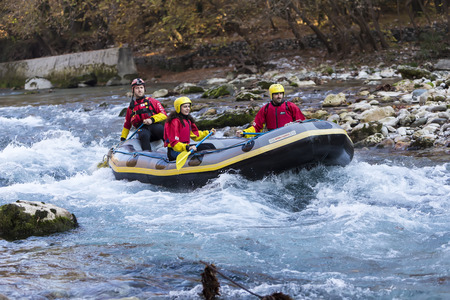 rafters: Konitsa, Epirus, Greece, November 16 2015: Adventurous group doing white water rafting the rapids of river Voidomatis in Konitsa.Voidomatis river is one of the most popular among rafters in Greece Editorial