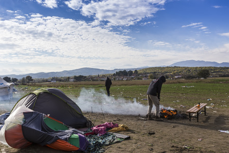 immigrants: Idomeni, Greece,  November 29, 2015: Hundreds of immigrants are in a wait at the border between Greece and FYROM waiting for the right time to continue their journey from unguarded passages