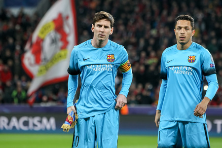 lionel messi: Leverkusen, Germany- December 9, 2015: Lionel Messi (L) and Adriano (R) during the UEFA Champions League game between Bayer 04 Leverkusen vs Barcelona at BayArena stadium