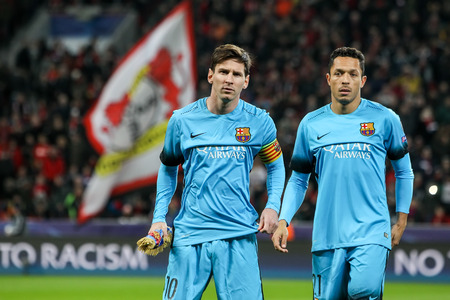 messi: Leverkusen, Germany- December 9, 2015: Lionel Messi (L) and Adriano (R) during the UEFA Champions League game between Bayer 04 Leverkusen vs Barcelona at BayArena stadium