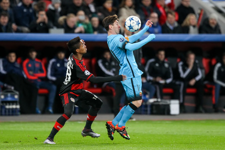Leverkusen, Germany- December 9, 2015: Lionel Messi (R) and Wendell (L) during the UEFA Champions League game between Bayer 04 Leverkusen vs Barcelona at BayArena stadium