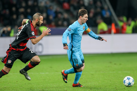 lionel messi: Leverkusen, Germany- December 9, 2015: Omer Toprak (L) and Lionel Messi (R) during the UEFA Champions League game between Bayer 04 Leverkusen vs Barcelona at BayArena stadium Editorial