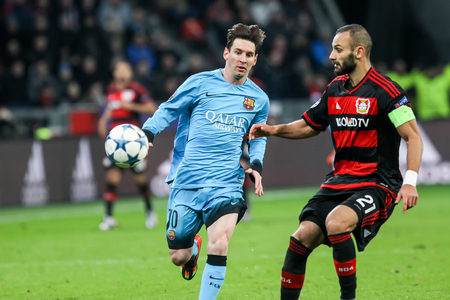 lionel: Leverkusen, Germany- December 9, 2015: Omer Toprak (R) and Lionel Messi (L) during the UEFA Champions League game between Bayer 04 Leverkusen vs Barcelona at BayArena stadium Editorial