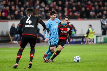 messi: Leverkusen, Germany- December 9, 2015: Lionel Messi (L) and Hakan Calhanoglu (R) during the UEFA Champions League game between Bayer 04 Leverkusen vs Barcelona at BayArena stadium