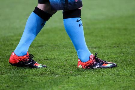 messi: Leverkusen, Germany- December 9, 2015: The feet of Lionel Messi during the UEFA Champions League game between Bayer 04 Leverkusen vs Barcelona at BayArena stadium