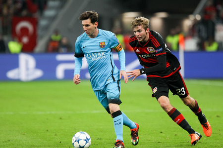 messi: Leverkusen, Germany- December 9, 2015: Christoph Kramer (R) and Lionel Messi (L) during the UEFA Champions League game between Bayer 04 Leverkusen vs Barcelona at BayArena stadium Editorial