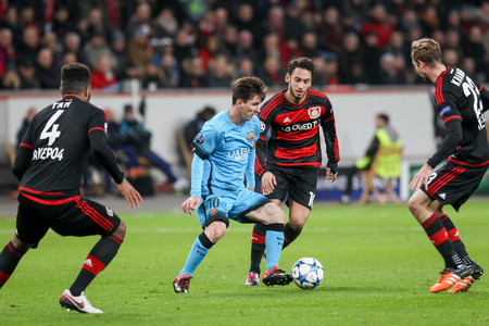 lionel messi: Leverkusen, Germany- December 9, 2015: Lionel Messi (L) and Hakan Calhanoglu (R) during the UEFA Champions League game between Bayer 04 Leverkusen vs Barcelona at BayArena stadium