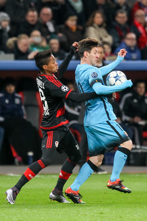 messi: Leverkusen, Germany- December 9, 2015: Lionel Messi (R) and Wendell (L) during the UEFA Champions League game between Bayer 04 Leverkusen vs Barcelona at BayArena stadium