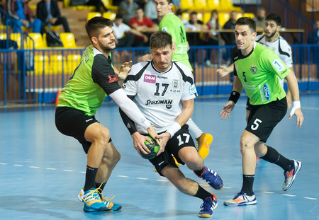 handball: Thessaloniki, Greece, Oct 17, 2015: Some Handball players in action during the game for the Greek Handball Championship PAOK vs Diomidis Editorial