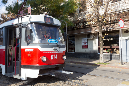 krasnodar: Krasnodar, Russia, November 5, 2015: Retro tram arrives at the stop of public transport in Krasnodar, Russia. Editorial