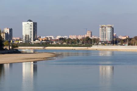 krasnodar: Krasnodar, Russia, November 5, 2015: Waterfront cityscape from the central pier in Krasnodar in the morning, Krasnodar, Russia.