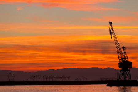 offshore jack up rig: Silhouette of a drilling rig against dramatic sunset Stock Photo