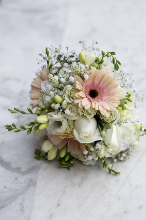 marvel: Beautiful Brides wedding bouquet on marvel floor