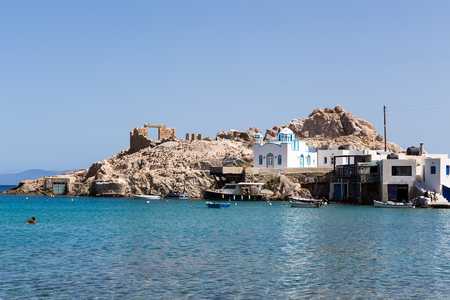 kyklades: Milos, Greece - September 11, 2015: Blue White orthodox church at Firopotamos, Milos island, Cyclades, Greece