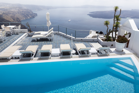 Luxury resort swimming pool in Santorini, Greece Editorial