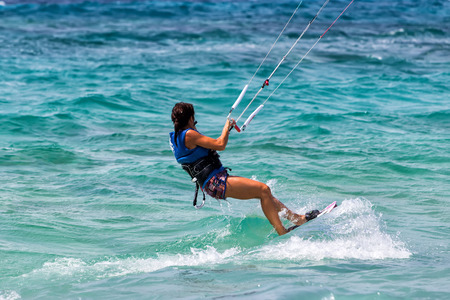 Lefkada, Greece, August 12 2015: Kitesurfers on the Milos beach in Lefkada. Milos beach is most popular places in Greece for kitesurfing.