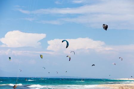 kitesurfing: Lefkada, Greece, August 12 2015: Kitesurfers on the Milos beach in Lefkada. Milos beach is most popular places in Greece for kitesurfing.