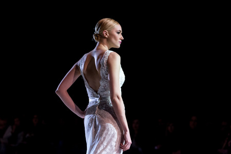 runway fashion: Thessaloniki, Greece, January 16 2016: A model walks the runway during fashion show 14th Expo Wedding.