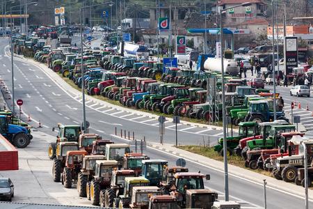 planned: Tempe, Greece, January 22 2016: Protesting farmers from the agricultural region of Thessaly arrive with their tractors in Tempe Vale, Greece. Τo protest against governments planned social security reforms.