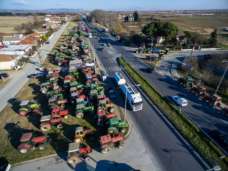 planned: Chalkidona, Greece, February 1 2016: Aerial photographs tractors that have lined up the farmers at the Chalkidona at north Greece  to protest against governments planned social security reforms. Editorial