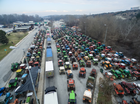 planned: Promachonas, Greece, January 20 2016:Aerial photographs tractors that have lined up the farmers at the border of Greece with Bulgaria to protest against governments planned social security reforms. Editorial