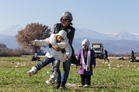 immigrants: Idomeni, Greece, February 7, 2016: Hundreds of immigrants are in a wait at the border between Greece and FYROM  waiting to cross the borders to FYR of Macedonia Editorial