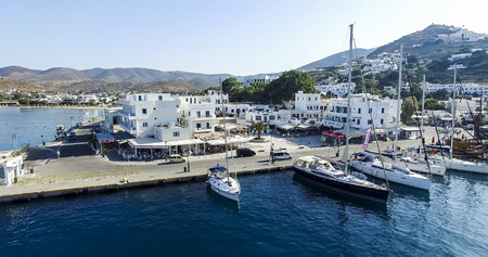 ios: Ios, Greece - September 19, 2015: View of the port and the coast of the Greek island of Ios island, Cyclades, Greece.