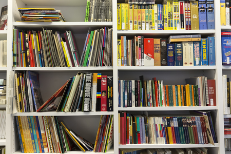 spines: Thessaloniki, Greece- November 14, 2015: Bookshelves in a bookstore in Thessaloniki, Greece Editorial