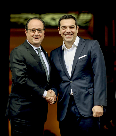 Athens, Greece - October 23, 2016: Prime Minister Alexis Tsipras and the President of France Francois Hollande during their meeting at the Maximos Mansion in Athens, Greece.